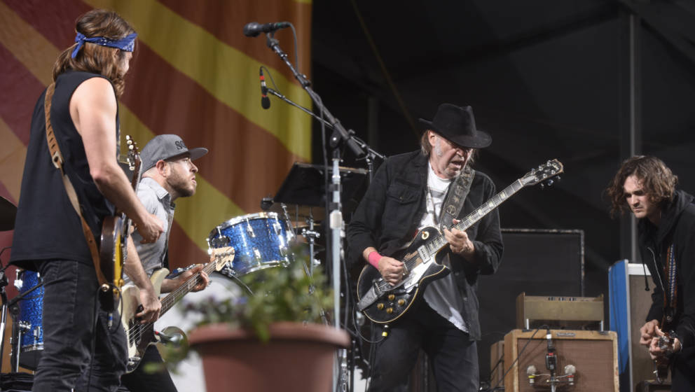 NEW ORLEANS, LA - MAY 01:  (L - R) Lukas Nelson, Neil Young, and Micah Nelson of Neil Young + Promise of the Real perform dur