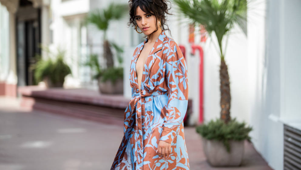 CANNES, FRANCE - JUNE 18: Camila Cabello is seen wearing pants and belted coat Johanna Ortiz on June 18, 2019 in Cannes, Fran