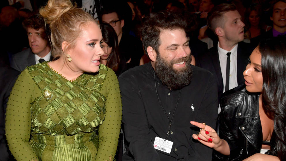LOS ANGELES, CA - FEBRUARY 12:  Singer-songwriter Adele (L) and Simon Konecki during The 59th GRAMMY Awards at STAPLES Center
