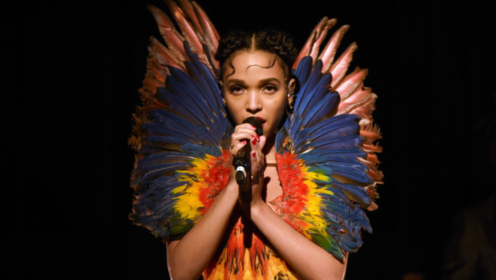 LONDON, ENGLAND - MARCH 12:  FKA Twigs performs at the Alexander McQueen: Savage Beauty Fashion Gala at the V&A, presente