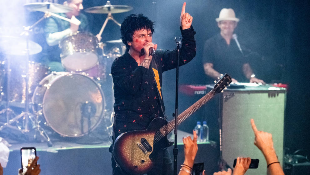 WEST HOLLYWOOD, CALIFORNIA - SEPTEMBER 10: (L-R) Tré Cool, Billie Joe Armstrong and Jason Freese of Green Day perform during