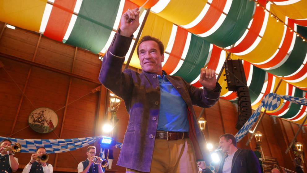 MUNICH, GERMANY - SEPTEMBER 22:  Arnold Schwarzenegger conducts the Orchestra in the Schuetzen-Festzelt (Shooting tent) durin