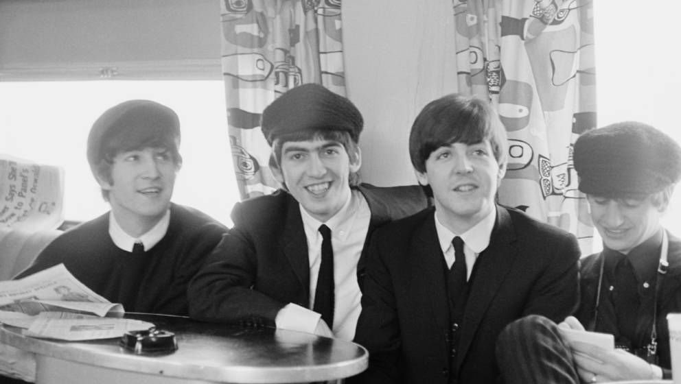 UNITED STATES - 1st FEBRUARY: The Beatles posed on a train to Washington during their tour of the USA in February 1964. Left