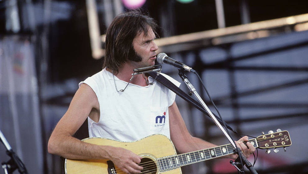 (MANDATORY CREDIT Ebet Roberts/Getty Images) PHILADELPHIA, USA - 13th JULY: Canadian singer/songwriter Neil Young perofrms li
