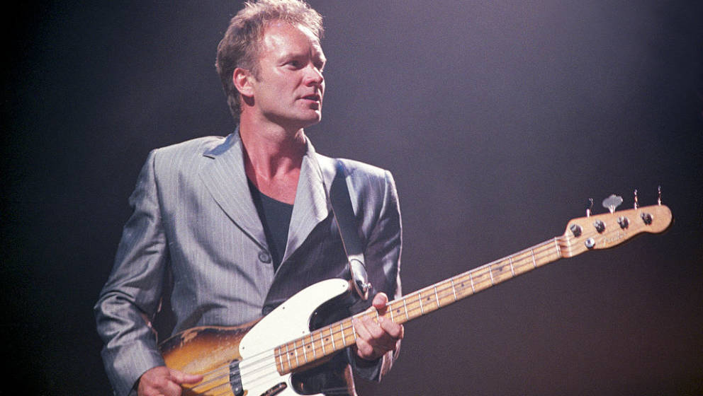 Sting performs on stage in 1996. (Photo by Phil Dent/Redferns)