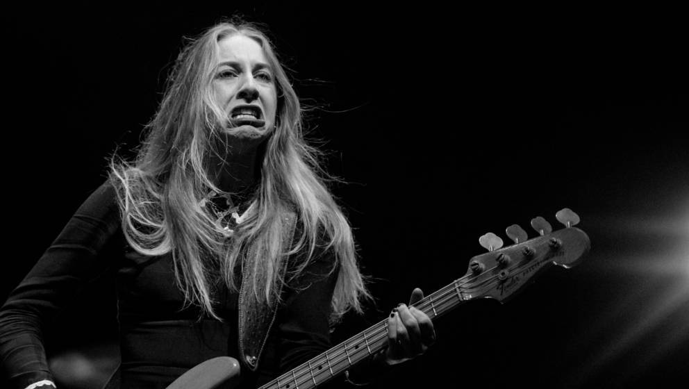 LOS ANGELES, CA - AUGUST 24:  (EDITORS NOTE: Image has been converted to black and white.) Este Haim of Haim performs onstage