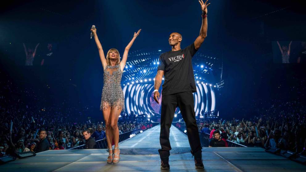LOS ANGELES, CA - AUGUST 21:  Singer-songwriter Taylor Swift (L) and NBA player Kobe Bryant speak onstage during The 1989 Wor