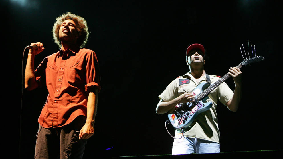 LAS VEGAS - OCTOBER 28:  Rage Against the Machine singer Zack de la Rocha (L) and Tom Morello perform during the Vegoose musi