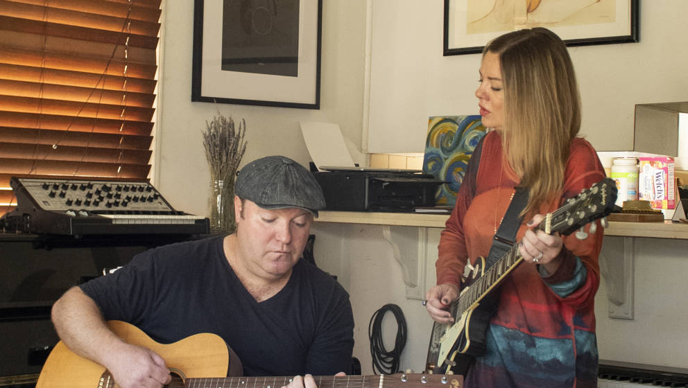 In this illustration picture songwriters/musicians Cole Newman and his wife Becky work on songs during the Covid-19 crisis on