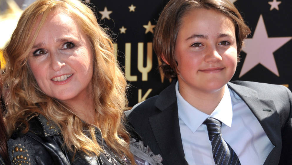 This photo taken on September 27, 2011 shows singer Melissa Etheridge posing with her son Beckett during her Walk of Fame cer