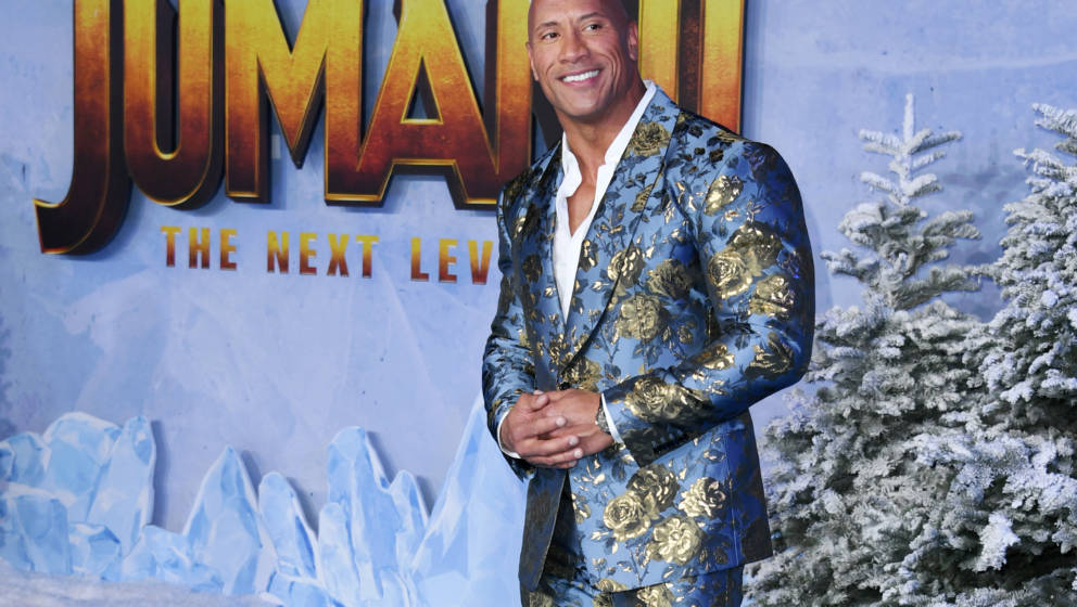 HOLLYWOOD, CALIFORNIA - DECEMBER 09:  Dwayne Johnson attends the premiere of Sony Pictures' 'Jumanji: The Next Level' on Dece