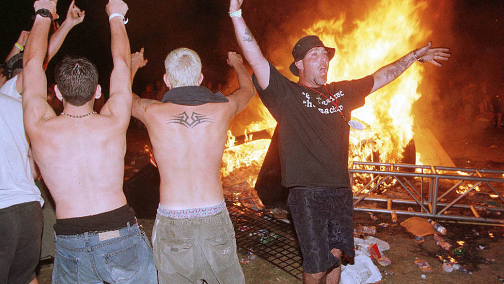 370824 01: Fans ignite plywood and debris at the conclusion of Woodstock ''99, July 25, 1999 in Rome, N.Y. An estimated 250,0