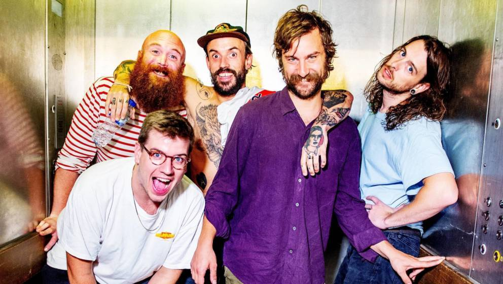 Adam Devonshire, Jon Beavis, Joe Talbot, Mark Bowen and Lee Kiernan of Idles pose backstage after performing live and signing