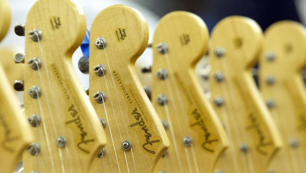 CORONA, UNITED STATES:  Stratocaster guitars at the Fender manufacturing facility in Corona, California, 28 June 2004.  The s