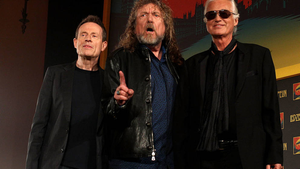 LONDON, ENGLAND - SEPTEMBER 21:  (L-R) John Paul Jones, Robert Plant and Jimmy Page of Led Zeppelin attend a press conference