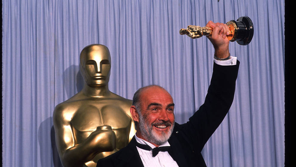 049944 25: Actor Sean Connery holds up his Best Actor in a Supporting Role Oscar for 'The Untouchables' at the Academy Awards