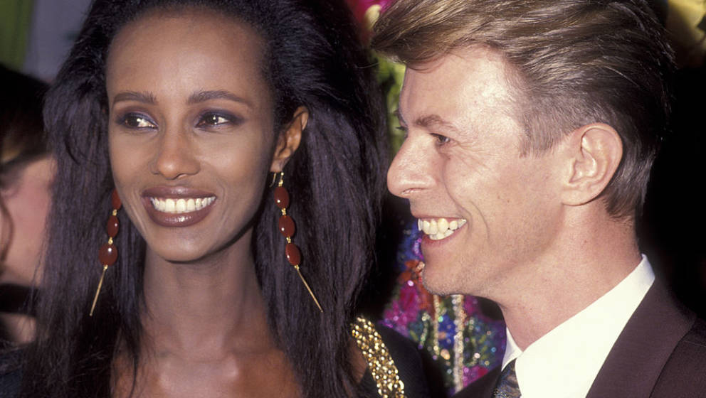 Musician David Bowie and model Iman attend Seventh on Sale AIDS Benefit on November 29, 1990 at the Armory in New York City.