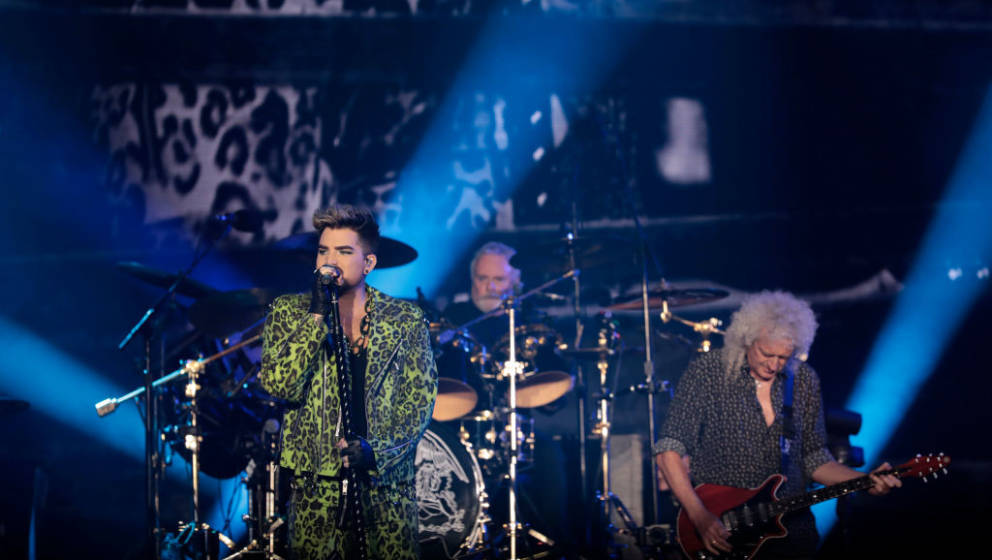 SYDNEY, AUSTRALIA - FEBRUARY 16: Adam Lambert (L) performs with Brian May of Queen during Fire Fight Australia at ANZ Stadium