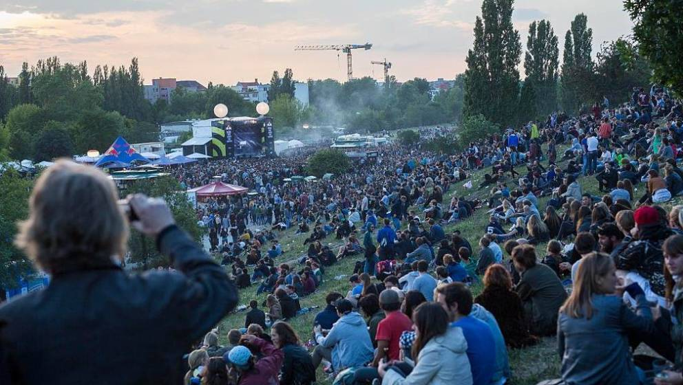 BERLIN, GERMANY - JUNE 21:  People enjoy in Mauerpark district during the annual 'Fete de la Musique' music fest on June 21,
