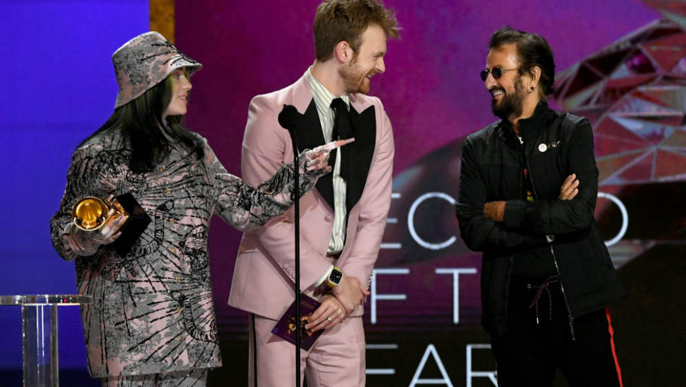 LOS ANGELES, CALIFORNIA - MARCH 14: (L-R) Billie Eilish and FINNEAS accept the Record of the Year award for 'Everything I Wan