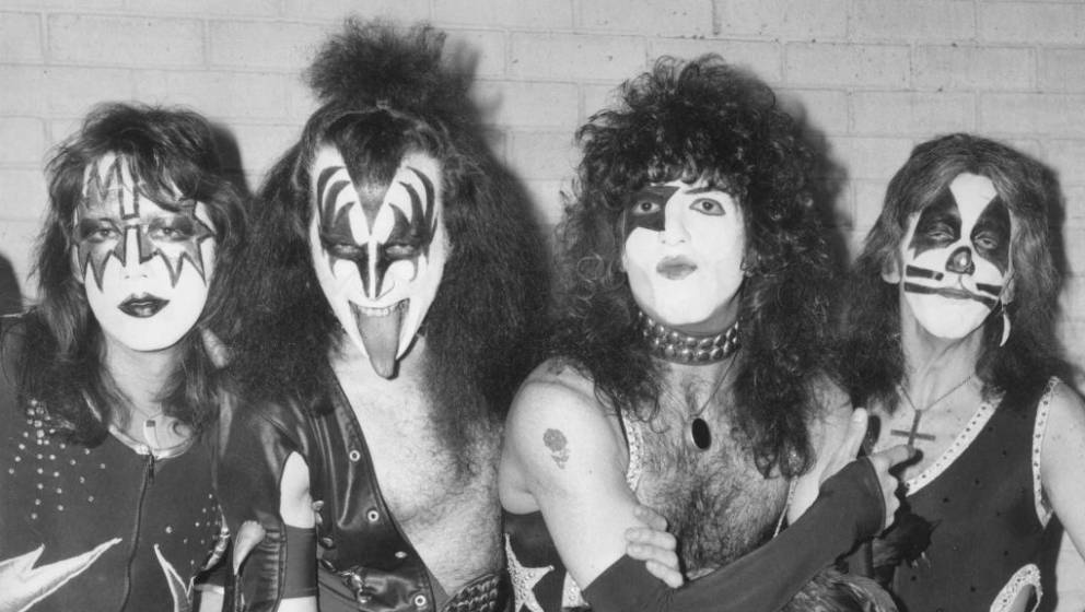 10th May 1976:  American rock group Kiss arrive at London airport for their first European tour, already sporting black and s