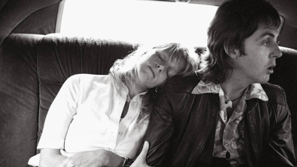 Linda rests her head on Paul's shoulder on the way to New York's LaGuardia airport. May 26, 1976.