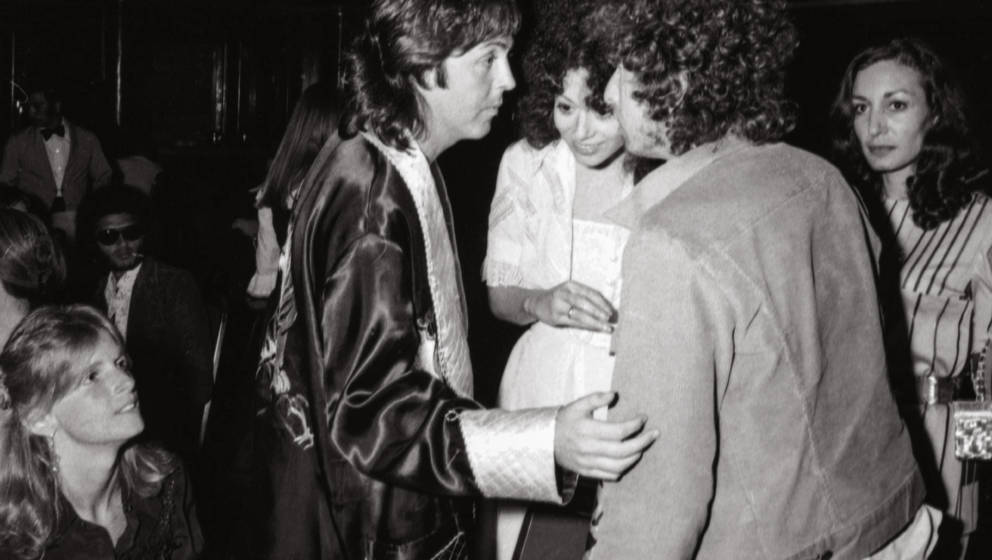 Paul talks to Bob Dylan on board the Queen Mary, at the launch party for the Wings' record Venus and Mars. Long Beach, Cali