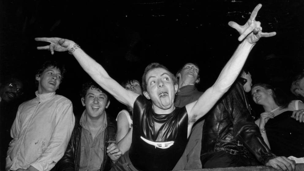 14th May 1977:  A punk 'spazzing' at the Rainbow Theatre in London while The Clash and The Jam play in concert.  (Photo by Ch