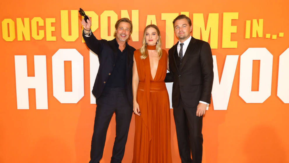 LONDON, ENGLAND - JULY 30:  (L-R)  Brad Pitt, Margot Robbie and Leonardo DiCaprio attend the UK Premiere of Once Upon A Time.
