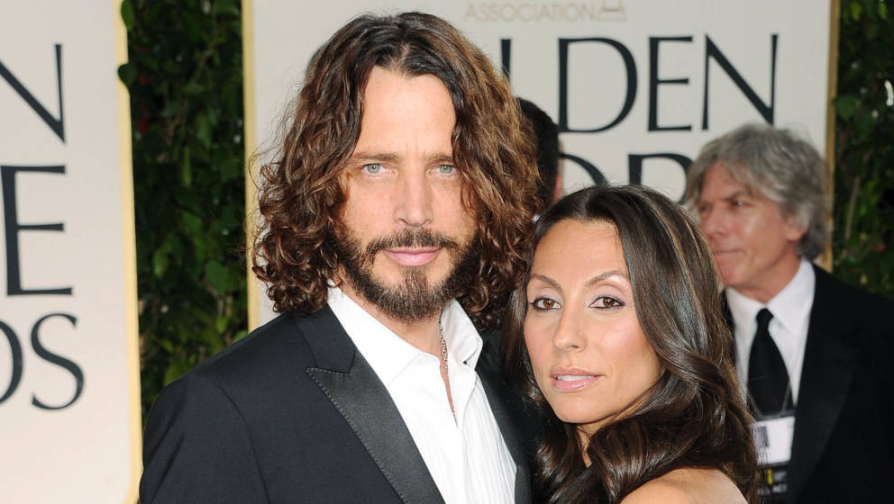 BEVERLY HILLS, CA - JANUARY 15:  Musician Chris Cornell (L) and wife Vicky Karayiannis arrive at the 69th Annual Golden Globe