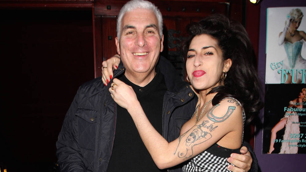 LONDON, UNITED KINGDOM - OCTOBER 07: Amy Winehouse and her father Mitch Winehouse sighted outside Cityburlesque where her fat