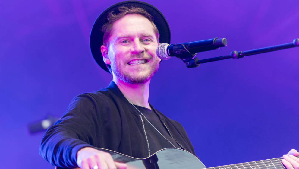 BONN, GERMANY - AUGUST 18: German singer Johannes Oerding performs on stage at the BonnLive Kulturgarten on August 18, 2021 i