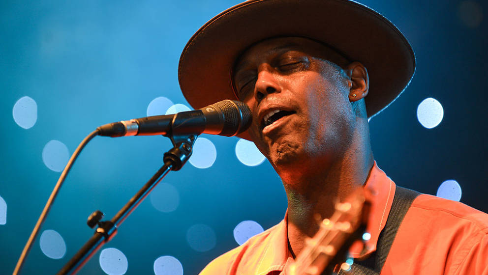 LEWES, ENGLAND - JULY 06:  Eric Bibb performs on stage during Love Supreme Jazz Festival 2013 on July 6, 2013 in Lewes, Unite